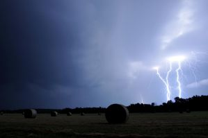 Lightning Storm Over Hay Field by Bvilleweatherman
