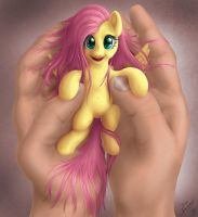 holding my tiny Fluttershy by blueSpaceling