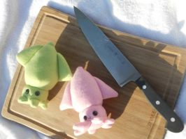 Squids on the Cutting Board by Love-Who