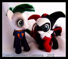 The Joker and Harley Quinn by chickygrrl