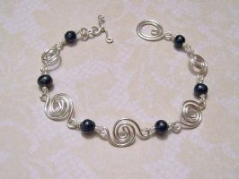Silver spiral / midnight pearl bracelet by asukouenn