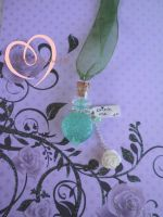 We planted the white roses by mistake Alice bottle by ilikeshiniesfakery
