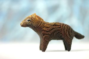 Animal totem sculpture - bush dog by hontor