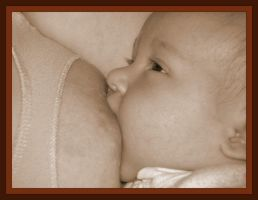 Baby at the breast 2 by jgrockphotos