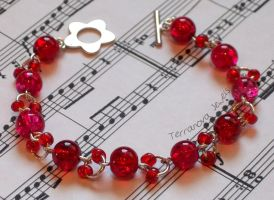 Red and silver bracelet with daisy flower toggle by TerraNovaJewels