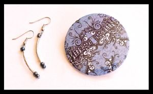 Badge and earrings by hippiedesigner