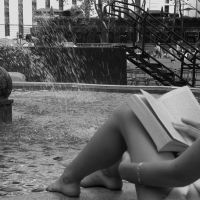 Reading by the fountain by EllieZ