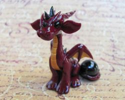 Red Dragon with Orb by DragonsAndBeasties
