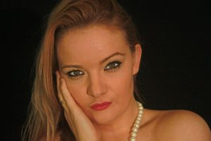 Face and hand with pearls by photomole