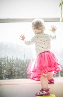 Baby girl in tutu at window by Sinned-angel-stock