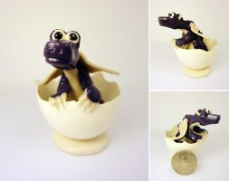 Purple dragon in egg by Koreena