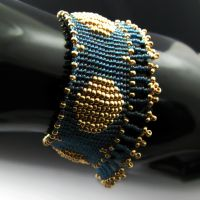 Blue and golden bead loomed bracelet with fringe by CatsWire