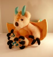 Gold and Blue teddy Dragon by Jadetiger