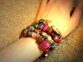 Hand-rolled beaded bracelet by moonwolf17