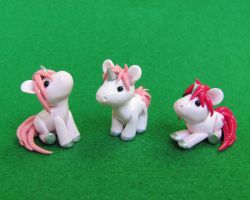 Pink Baby Unicorns by DragonsAndBeasties