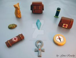 Fondant Tomb Raider Items by ginas-cakes