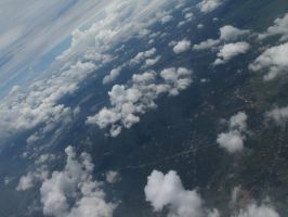 Clouds from Airplane Window 3 by Scorpini-Stock
