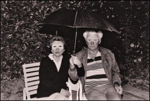 Parents and umbrella by SUDOR