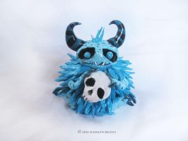 Little Fuzz Puff with Skull Sculpture by NadilynBeato