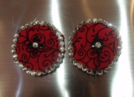 Red swirly pasties with card buttons by IAteAllMyPaste
