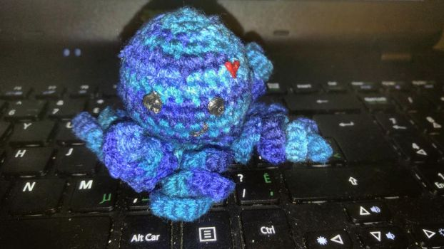 Tiny blue octoplush  by TehKnittyKitty