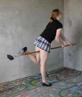 playing with a broom 3 by indeed-stock