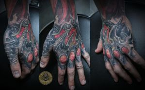 Biomech Hand Tat by 2Face-Tattoo