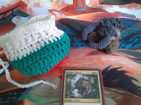 Dice bag and Woolly Thoctar (Magic: The Gathering) by Hiebsi