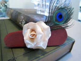 White Rose with Peacock Feather on Red Silk by spaceraptor