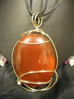 simple free form carnelian pendant by BacktoEarthCreations