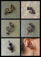 Wire-wrapped earcuffs by ZombieArmadillo