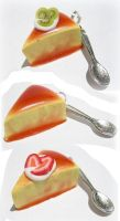 Fancy flan slices with spoons by strawberrywafers