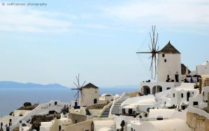 The Windmills of Oia by redfiretrees