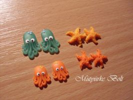 Starfish and octopus stud earrings by RodionYaoi