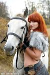 Barbarian with her horse by Angmara