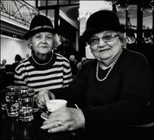 Ladies in cafe by Dionisic