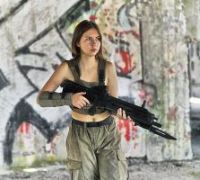 Polina with rifle #2 by ohlopkov