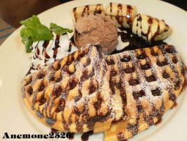Waffles with Banana and chocolate sauce. by anemoneploy