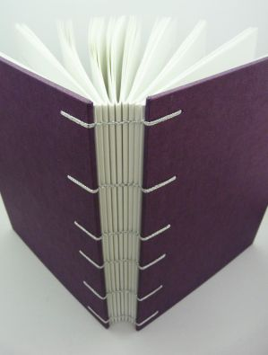 A5 lined purple coptic journal outside by ThePressGang-ink