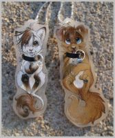Leigh and Kyle necklaces by SirKittenpaws