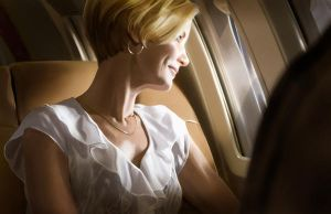 Woman on airplane by VictorGatmaitan