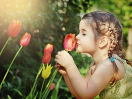 Little girl and Tulips 1 by Swan-Lake