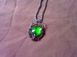 Green wire wrapped pendant by EatThatCookie