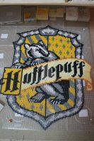 Hufflepuff house emblem in perler by mininete