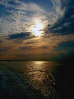 Sun over Solent by crimsonian