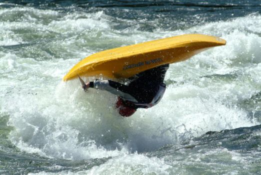 Yellow kayak in mid-air by coloma