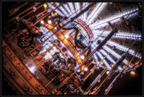 Merry go around under the Eiffel tower in Paris by stevegek
