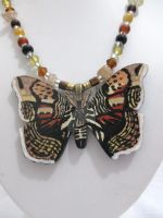 Hand painted moth pendant on beaded necklace by TanzenLilly