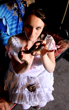Laura: The Snake Charmer by visualassult