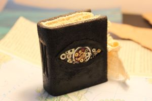 Miniature steampunk style book /mechanical eye by izibel1